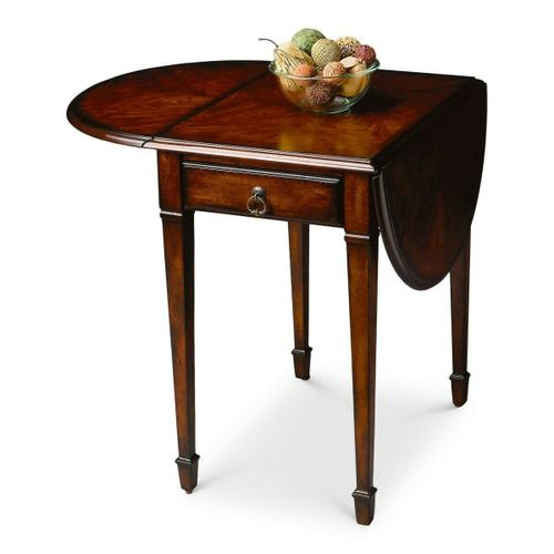 Thanks to its drop-leaf design, this antique reproduction pembroke table is wonderfully versatile and suitable for both small spaces and larger rooms. Handcrafted from select wood solids and wood products, the top features a maple and walnut veneer linen-fold inlay design set within matched cherry veneers, and matched cherry veneer leaves. Includes one drawer with antique brass finished hardware.