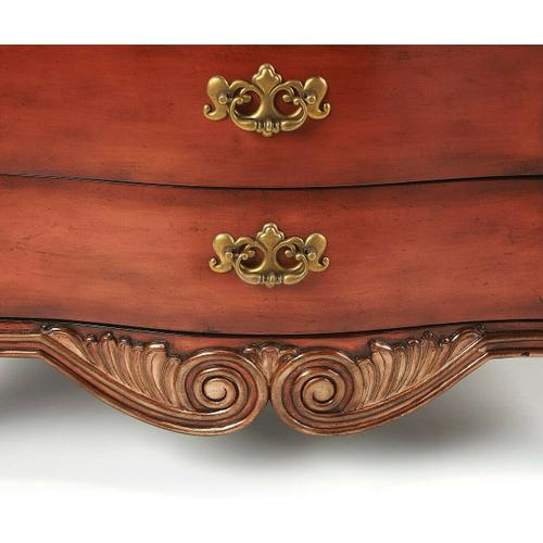 Butler Specialty Company - Selected solid woods and wood products. Resin components and accents. Fossil stone veneer top with inlaid brass border. Three drawers with antique brass finished hardware.