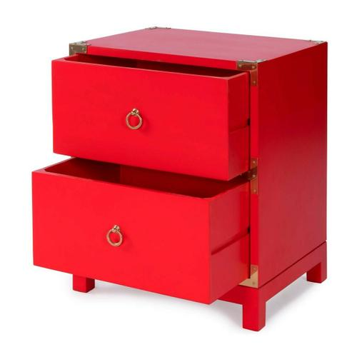 This striking campaign-inspired Chairside Chest is sure to be the focal point of any living room or bedroom. Crafted from mango wood solids and wood products, it boasts a bold red finish and two storage drawers with brass ring pulls and matching corner ha