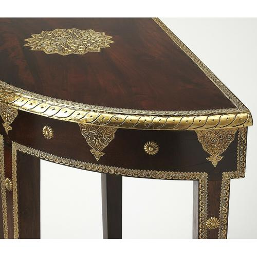 Butler Specialty Company - This magnificent demilune features intricately hand-applied gold foil on legs, base and top, covering the entire drawer front. Note also the stunning lotus leaf on the tabletop. Crafted from mango wood solids in the Espresso finish.