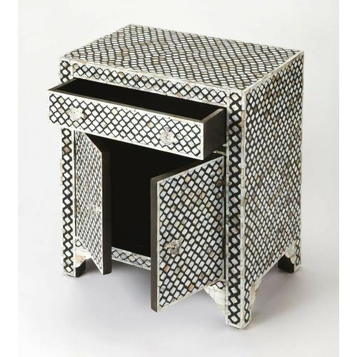 Butler Specialty Company - This alluring accent chest is certain to be the focal point in a living room, bedroom or entryway. Expertly crafted from merranti wood solids and wood products, it features gorgeous mother of pearl inlays in a Moroccan quatrefoil pattern against a black resin background. For function, there is a drawer and lower storage cabinet with clear acrylic pulls.