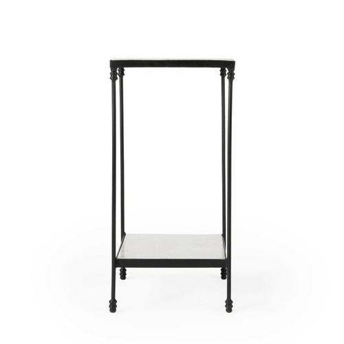 This plain and simple Larkin accent table is nothing less than fashionable. The black iron legs support smooth white marble slabs. This table is functional and allows for your needs, in style and space.