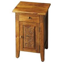 The warm amber finish provides the perfect complement to this chairside chest's simple lines, brass-finished hardware and botanic flourishes carved on door panel and either side of the drawer front. An instant classic, crafted from mango wood solids and w