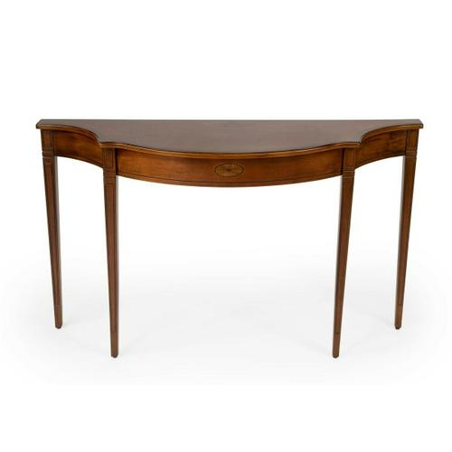 This Pembroke-inspired console is highly elegant, yet unpretentious. Ideal in a hallway, foyer or entryway, it is crafted from rubberwood solids and wood products featuring beautiful curves with a cherry veneer top, linen-fold inlay patterns of maple and