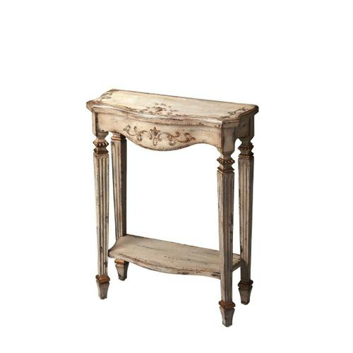Attention to detail gives this Console Table genuine distinction: the carved legs tapering down into ballerina feet the way the front legs are turned 45 degrees from those on the back row the beautifully hand-painted front apron and tabletop and