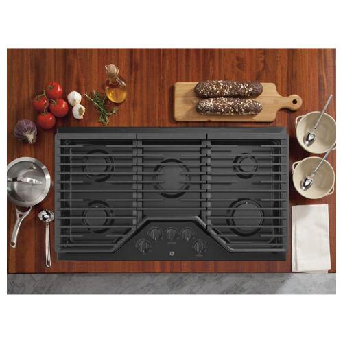 "GE 36"" Built-In Gas Cooktop with 5 Burners and Dishwasher Safe Grates / New Open Box / Carton Damage / Perfect Condition / Pick Up Only / Linthicum MD / CNT ID:490477"