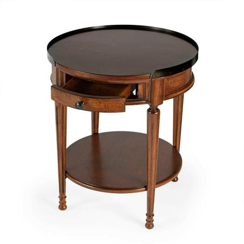 Adorned with four-way matched cherry veneers, the top of this stately accent table boasts an antique brass finished gallery that matches the drawer knob. Elegantly crafted from selected solid woods and wood products.