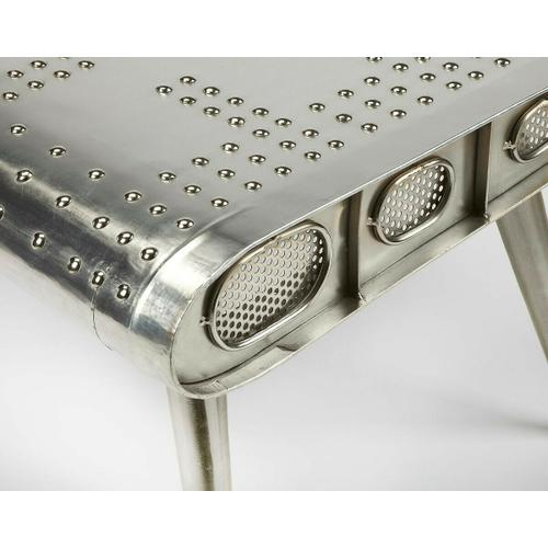 Butler Specialty Company - This table is riveting, soaring with the flair of an airplane wing and guaranteed to help a room take flight. Resplendent in shimmering aluminum, the table sits atop three matching legs that taper down for a very smooth landing indeed.