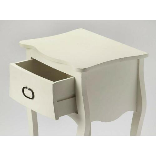 Butler Specialty Company - Crafted from Mango wood solids in a white finish; this nightstand is perfect for stowing bedside essentials and flanking your master bed in as a pair, this lovely nightstand showcases a single drawer, scalloped apron and lower display shelf.