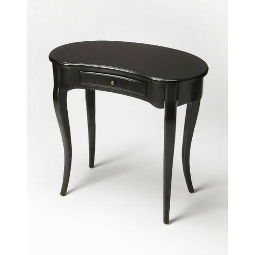 Butler Specialty Company - This elegant Writing Desk features a crescent shape tabletop supported by four stylized, tapered cabriole legs and a drawer with antique brass-finished hardware. It is crafted from solid poplar and cherry veneer in a Black Licorice finish.