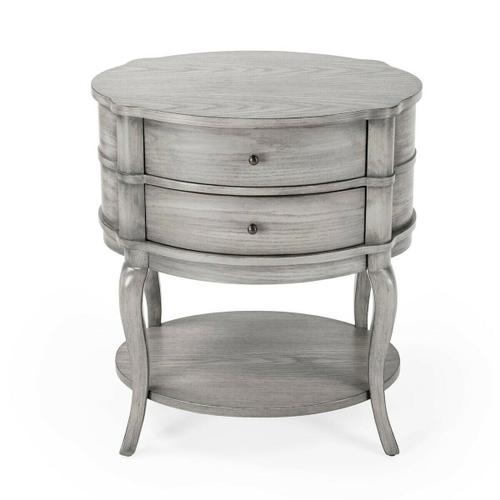 Butler Specialty Company - With polished curves and subtle finesse, this transitionally styled table has a sleek,functional design that suits almost every decor. Featuring a Grey finish and two drawers with antique brass-finished hardware plus a bottom shelf, this classic table is a beautiful chairside or bedside addition.