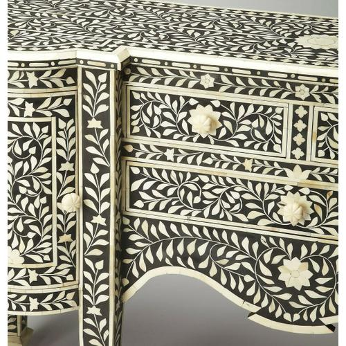 Butler Specialty Company - This magnificent Buffet features sophisticated artistry and craftsmansip. The botanic patterns covering the piece are bone inlays formed and applied individually by the hands of a consummate artisan. No two pieces are ever exactly alike, ensuring this Buffet is a bonafide orginal.