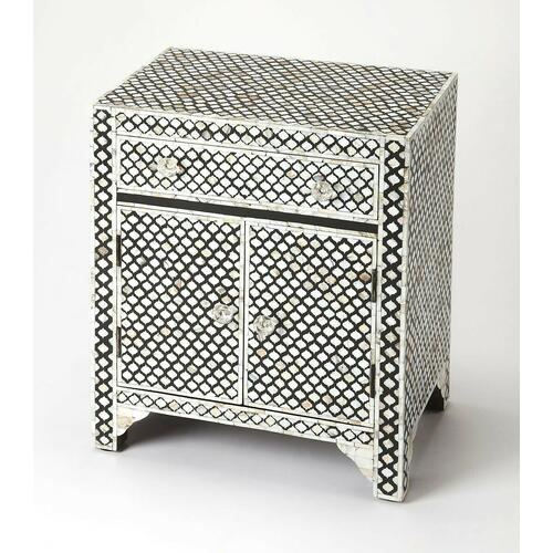 This alluring accent chest is certain to be the focal point in a living room, bedroom or entryway. Expertly crafted from merranti wood solids and wood products, it features gorgeous mother of pearl inlays in a Moroccan quatrefoil pattern against a black r