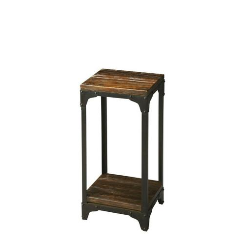 Hand-crafted from iron and solid mango wood, this distinctive pedestal stand is small in stance, yet rugged in appearance. Its black iron frame and burnt umber wood finish on the top and lower display shelf complement each other well.