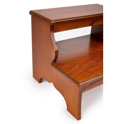 This artisan-crafted step stool was designed to provide that extra step-up. Equally well-suited for use beside the bed, in the den or kitchen, it may be used wherever a little extra reach is needed. Finished in Olive Ash Burl.
