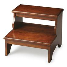 This artisan-crafted step stool was designed to provide that extra step-up. Equally well-suited for use beside the bed, in the den or kitchen, it may be used wherever a little extra reach is needed. It is crafted from select hardwood solids, wood products and choice cherry veneers. Finished in a rich chestnut stain.