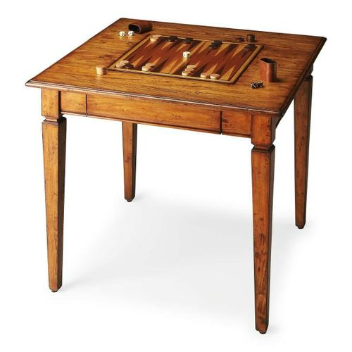 Butler Specialty Company - Crafted from gemilina solid wood in a transparent finish to showcase beautiful wood grains, knots and all. The playing surface flips from backgammon on one side to chess/checkers on the other with a storage drawer for game pieces. The tabletop is beveled, and the legs are tapered. Game pieces may be ordered separately.
