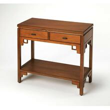 Modern with a definite Asian flair, this distinctive console table is destined to attract attention in your space. Crafted from bayur wood solids and okoume veneer, it features two drawers with black metal hardware, a lower display shelf and a warm carame