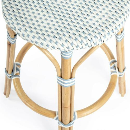 Evoking images of sidewalk tables in the Cote d'Azur, counter stools like this will give your kitchen or patio the casual sophistication of a Mediterranean coastal bistro. Expertly crafted from thick bent rattan for superb durability, it features weather resistant woven plastic in a navy pattern. This backless counter stool is lightweight for easy mobility with comfort to make the space it's in a frequent gathering place.