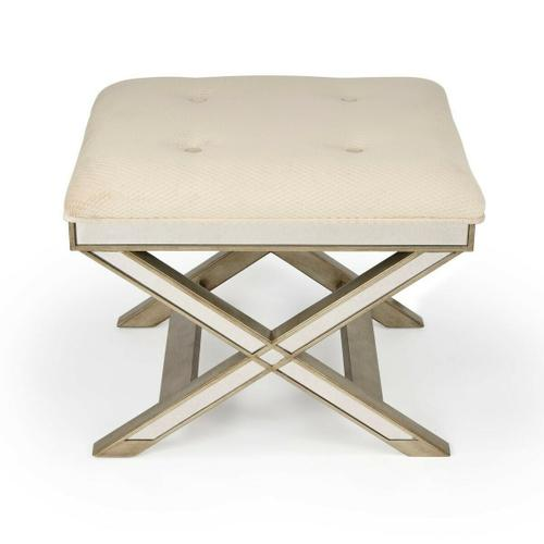 Butler Specialty Company - This striking vanity stool is a glamorous addition to virtually any space. Big on look with antique finished mirror inlays on its apron and X legged base. It functions beautifully in a bedroom, powder room as a stool, or as an ottoman in other living spaces. Hand crafted from hardwood solids and wood products, its pewter finish is refreshingly modern, and it also features an ivory button-tufted cotton upholstered cushion.