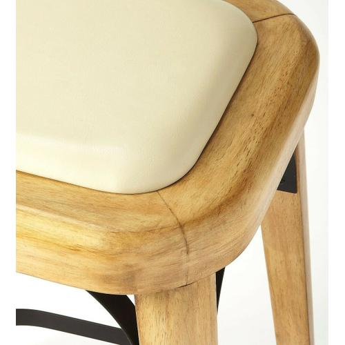 Curves, curves, everywhere you see the charming curves of this Acacia, Pine and iron counter stool. Natural wood shades blend and contrast to frame a faux leather seat. Tapered legs get extra support from a 4-sided iron stretcher and flat iron seat supports. Pull these up to your counter for a charming rustic aesthetic.