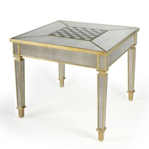 Butler Specialty Company - This stunning game table will add pizzazz to any living room, den, or home office. Accentuated by antique mirrored inlays on the top, along its apron, and down its gracefully tapered legs, it is glamorously outlined in a contrasting champagne colored finish. The center top panel is reversible with a gameboard on one side ™ for chess or checkers ™ and a fully mirrored panel on the other when the games have ended. This game table's good looks will make it the focal point of any space, and its expert craftmanship from birch wood solids and engineered wood products are destined to make it last for many years to come.
