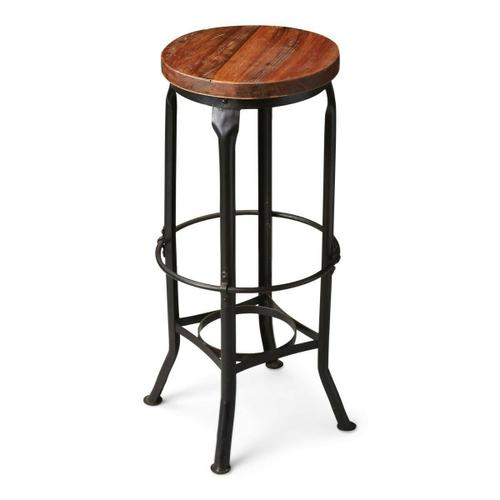 Butler Specialty Company - This aged, industrial-look bar stool has a character all its own. Handcrafted from iron and recycled wood solids, it features a distressed finish and a series of circles from base to top and four legs with intriguing bends at top and bottom.