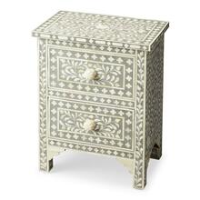 The elegance of the Indian subcontinent and thousands of years of artistisanry provide us with this contemporary two-drawer accent chest. Painstakingly handcrafted from wood solids and wood products, delicate bone inlay veneers, each pattern is hand-formed with unique design and unique delicacy, against a grey background. Complementary drawer pulls and carved leg braces provide character. This chest fits in any small space and provides an artistic showcase singly or in pairs.