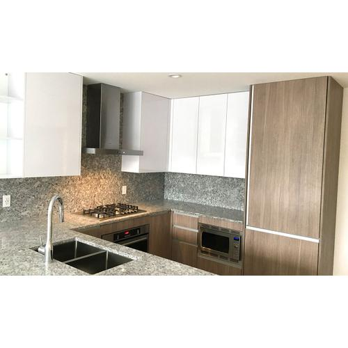 """30"""" T-shape chimney wall hood with Variable Air Management"""