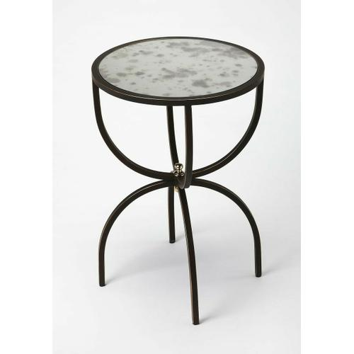 Stage a stylish lamp or family of framed photos atop this stainless steel end table. Looks great next to a modern sofa, the antiqued mirrored top with give your space a vintage flair. Four legs bound by a glimmering finial for a grade finale.