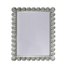 Easily At Home In Any Interior, the Eliza Rectangular Mirror Brings Elegant Texture and Visual Interest To Your Powder Room, Guest Suite, or Entry Hall. Features an Extraordinary Scallop Frame Detail Hand Crafted Silver Leaf Finish.