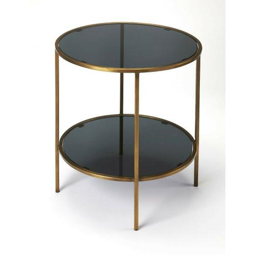 Butler Specialty Company - Enhance your living room, bedroom or office with this modern two-tiered round end table. Forged from iron, its antique gold finished frame supports a black glass top and bottom shelf.