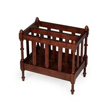 Organize your magazines and periodicals with this elegant magazine rack. Featuring a warm Antique Cherry finish and a center panel conveniently dividing the space inside into two compartments, it has spindled corner posts and slatted side panels. Crafted from mahogany wood solids and wood products with mahogany veneer.