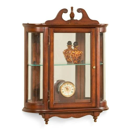 Butler Specialty Company - This distinctive wall curio is both functional and beautiful with two adjustable glass shelves and a mirrored back to display your prized possessions. The curved glass sides make it very unique. The glass paneled door features antique brass finished hardware. This future heirloom is made of select solid woods and wood veneers.