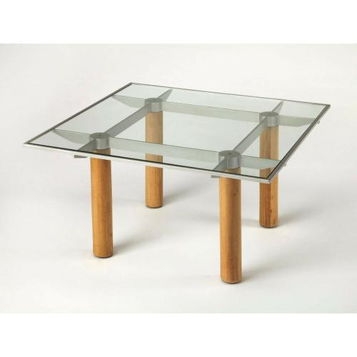 Butler Specialty Company - This square cocktail table blends materials for a unique techy modern aesthetic. Framed within a satin aluminum finished border, the table's clear tempered glass top provides a window to view its distinctive base - a blade-like assembly joining and supported by four solid gemelina wood legs in a light natural finish.