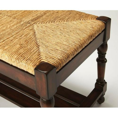 Butler Specialty Company - This spectacular bench will make a grand statement at the foot of a bed, an entryway or in virtually any other space. Hand crafted from solid mahogany wood solids, it features a meticulously woven banana leaf wicker seat, immaculately turned legs and a slatted shelf beneath the seat.