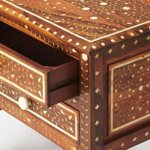 Butler Specialty Company - This beautifully handcrafted bone inlay accent chest is a treasure from the Far East. Crafted from sheesham wood solids and wood products, its wondrous botanical design is painstakingly created by carving into the wood and inlaying one individual piece of bone at a time. Blending artistry with function, it features two convenient drawers with carved bone pulls, and is a great addition in the living room or bedroom.