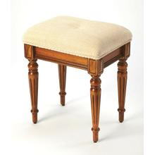 This splendid stool adds formal elegance to any bedroom, walk-in closet or anywhere where extra seating may be needed. Crafted from poplar hardwood solids, wood products and choice cherry veneers, it features a plush button-tufted cotton chenille upholstered seat with matched welting gracefully supported by four impeccably tapered legs. Use in alone, in multiples or pair with Butler game table style 5305101.