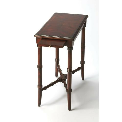 This elegant and traditional chairside table is a wonderful addition to any living room. Hand crafted from select wood solids, wood products and cherry veneers, it boasts an alluring hand rubbed Plantation Cherry finish. It also features a pull our drink