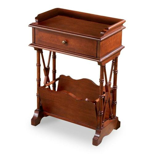 Ample storage and display space in this simply elegant Martini Table that combines function and aesthetics without sacrificing either. Handcrafted from hardwood solids, wood products and cherry veneers in a rich Plantation Cherry finish. Single drawer with antique brass finished hardware. Lower magazine rack.