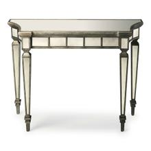 This beautiful console table will make a dramatic statement in the foyer or other living space. Expertly crafted from hardwood solids and wood products, it boasts graceful curves and antique mirror inlays on its top, apron and legs with a contrasting pewter finished trim.