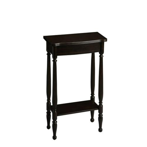 A graceful bright spot for a small space, the hallmark of this Console Table's exquisite design is the prominence of four slender legs ™ carved and turned and immaculately shaped. The petite tabletop and apron shimmer in our Rubbed Black finish. Craft