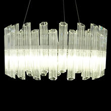 Clean and Fluted, This Chic Chandelier Features A Round of Clear Glass, LED Lighting, and an Artful Design That Complements Both Casual and Rich Atmospheres.