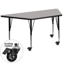 Mobile 25''W x 45''L Trapezoid Grey HP Laminate Activity Table - Height Adjustable Short Legs