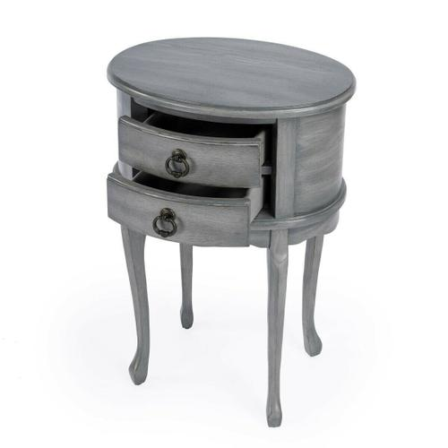 Butler Specialty Company - This charming oval side table combines elegant design details with convenient storage. It features a rich Powder Grey finish with light distressing. Hand crafted from select hardwood solids and wood products, it includes two drawers with antique brass finished hardware.