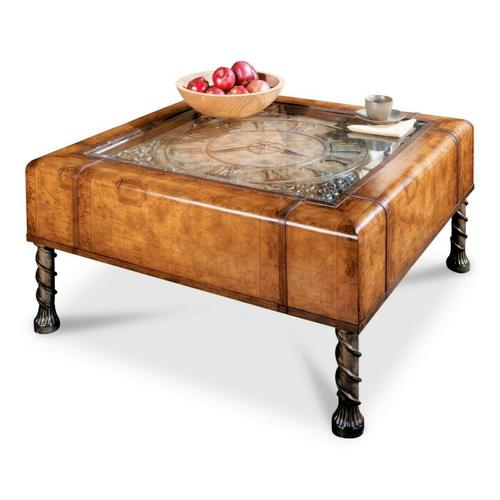 Butler Specialty Company - An instant heirloom, this unique cocktail table will be the focal point of any space. Featuring a distinctive old world map laminate glazed and lacquered to ensure years of beauty and utility. The top inset boasts a working clock beneath a beveled glass top. Leather trim and pewter finished legs complete the look of this stunning table. Hand crafted from wood products and resin components, it has a AA battery-operated quartz clock movement. The battery is not included.