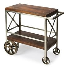 "Serve guests in style with this modern industrial trolley cart. Forged from iron, its frame has a zinc silver finish with stylish 'X"" side panels, and the mango wood top and bottom shelf have a vintage butcher block look in a clove brown finish. Use it for storage in the kitchen, dining room, bar or work space when not being used for entertaining."