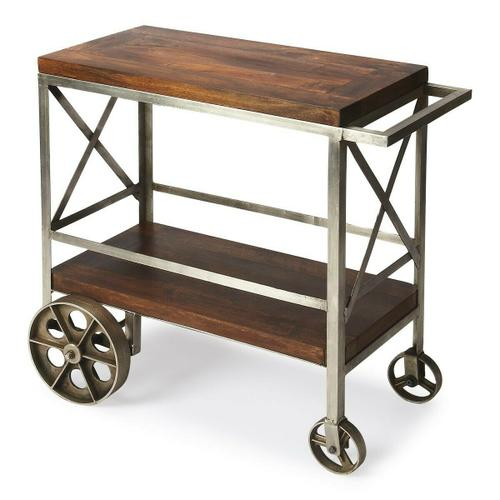 """Serve guests in style with this modern industrial trolley cart. Forged from iron, its frame has a zinc silver finish with stylish 'X"""" side panels, and the mango wood top and bottom shelf have a vintage butcher block look in a clove brown finish. Use it for storage in the kitchen, dining room, bar or work space when not being used for entertaining."""