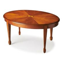 See Details - Timeless in its allure, this elegant cocktail table features a delicate maple veneer linen-fold inlay as its focal point and exquisitely tapered legs. Meticulously crafted from poplar hardwood solids and wood products, it boasts a matched cherry veneer top in a warm Olive Ash Burl finish.