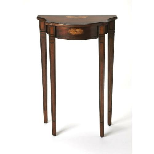This Pembroke-inspired console is highly elegant, yet unpretentious. Ideal for small spaces - in a hallway, foyer or entryway - it is crafted from rubberwood solids and wood products featuring beautiful curves with a cherry veneer top, linen-fold inlay pa